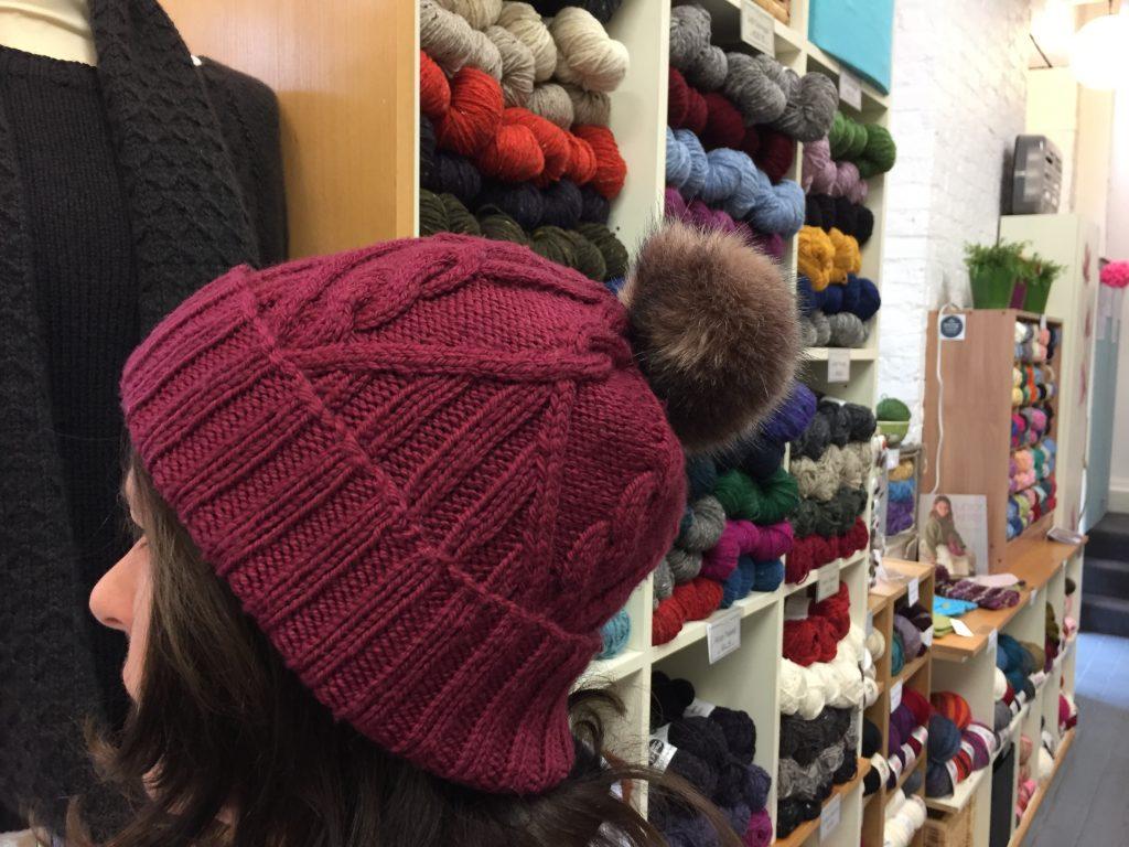 Curam Hat by Ysolda Teague knit in Debbie Bliss Falkland Aran modelled in This is Knit, Dublin