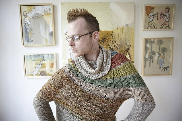 Image of the original Enchanted Mesa Design by Stephen West, featuring colourful yarns in an autumnal palette