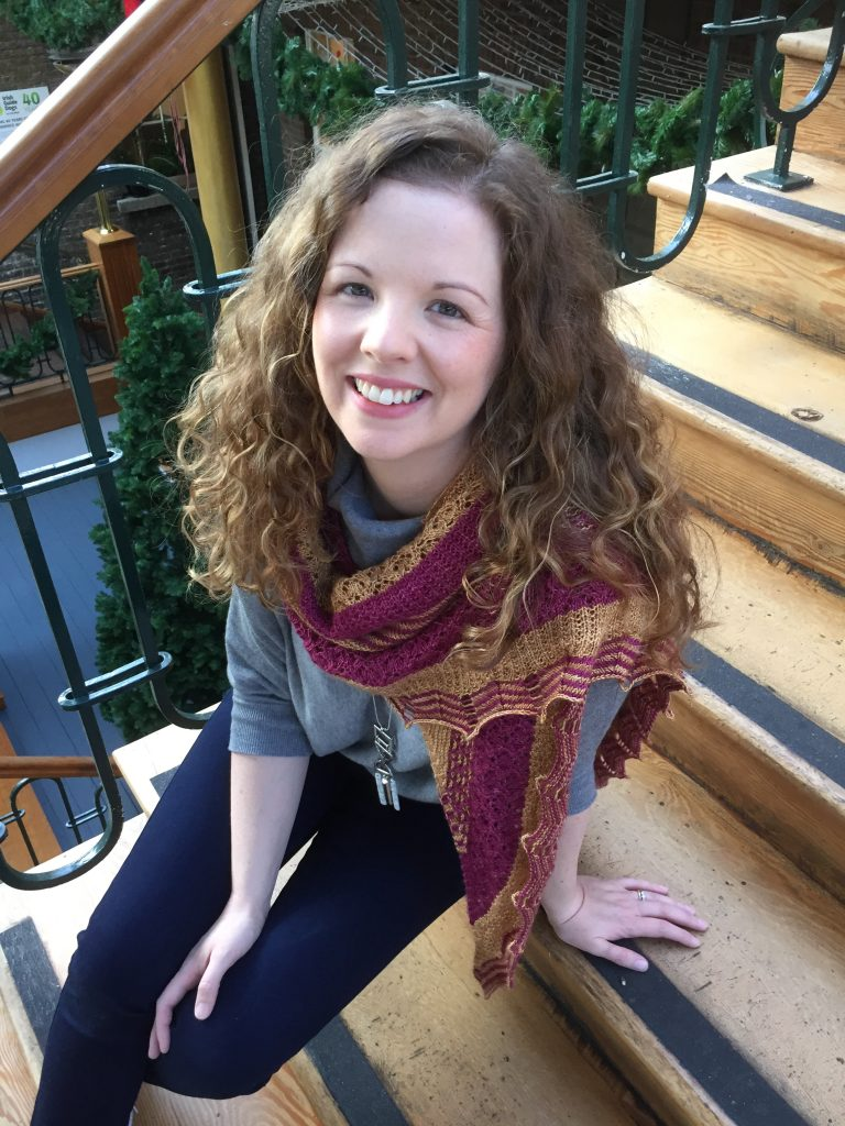 The Holyrood Shawl by Justyna Lorkowska in Townhouse Yarns Fade St 4ply. An elegant knitted shawl. Modelled.