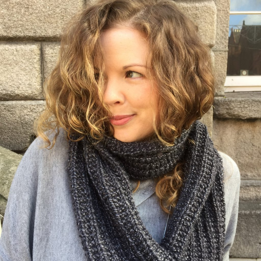 Mistake Rib Scarf pictured in front of the Powerscourt Townhouse. Knitted in Louisa Harding Trenzar. Simple scarf for beginner knitters.