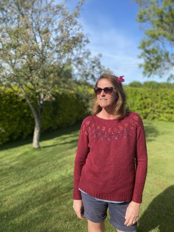 Jacqui wearing the Adelaide sweater standing in her backyard